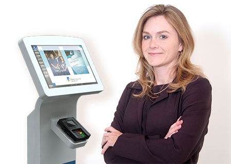 A woman stands in front of an Human Resources - HR kiosk