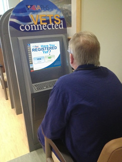 A man using a Vets Connected kiosk